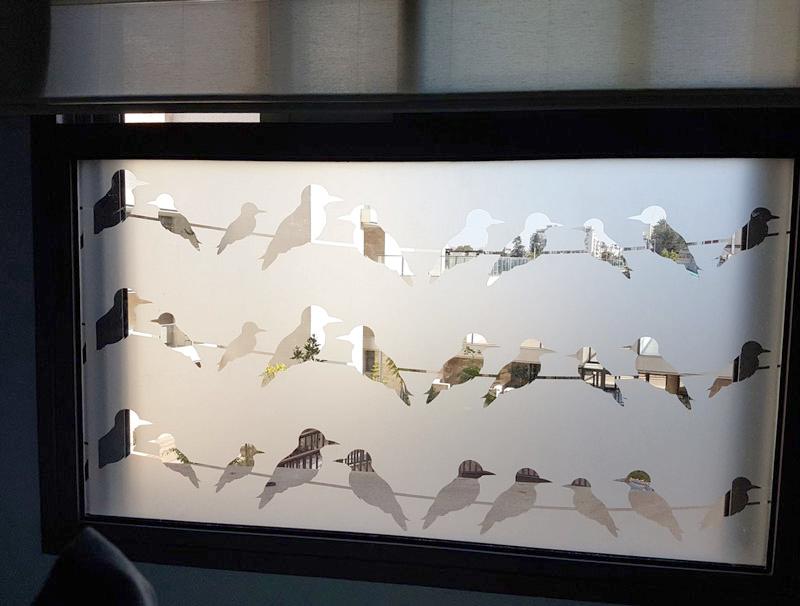 sticker   Birds sit on a wire